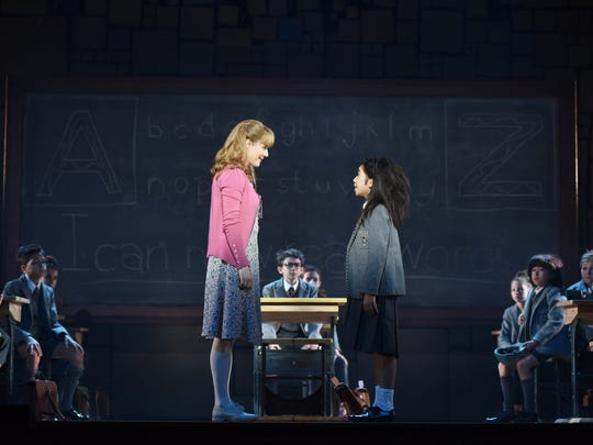 """Jennifer Bowles, left, who plays Miss Honey in the national tour of """"Matilda the Music,"""" is seen here with Gabby Gutierrez, one of three girls who alternate in the title role of the show. The stage adaptation of Roald Dahl's book runs through April 16 at the Aronoff Center as part of the Broadway in Cincinnati series."""