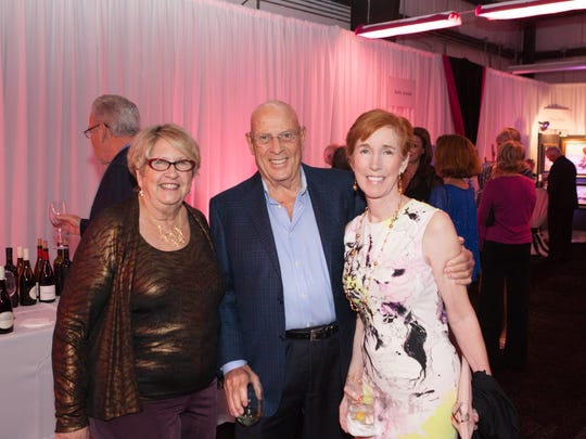 """Suzy Hutcheson, with Joe and Margaret Temple at the """"Pinot & Picasso"""" gala on Nov. 18 at the Helping People Succeed offices in Jensen Beach."""