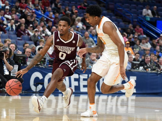 Mar 9, 2018; St. Louis, MO, USA; Mississippi State Bulldogs guard Nick Weatherspoon (0) drives to the basket as Tennessee Volunteers guard Jordan Bowden (23) defends during the first half of the quarterfinals of the SEC Conference Tournament at Scottrade Center. Mandatory Credit: Joe Puetz-USA TODAY Sports