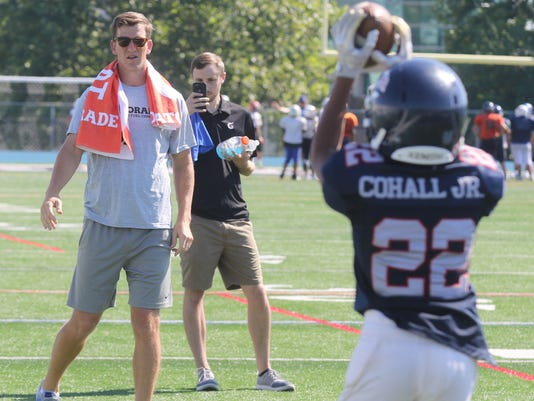 NY Giants quarterback Eli Manning came to a youth football camp held at Kean University to work out with young players and talk with them about the importance of hydration when practicing.
