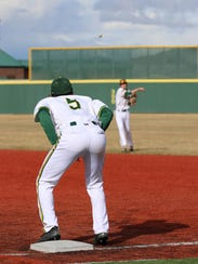 Rylan Charles waits for the throw at first base.