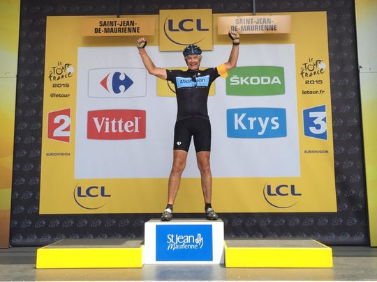"Doug Parrow of Keizer poses on the victory stand at the Tour de France finish in Sante Jean de Maurienne. Parrow joked on the Facebook post of the picture, ""I won, but there was no sign of the podium girls."""