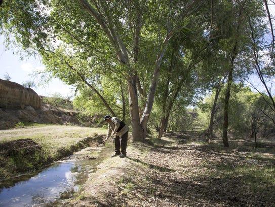 Robert Tenario Jr. (grounds keeper) checks irrigation,