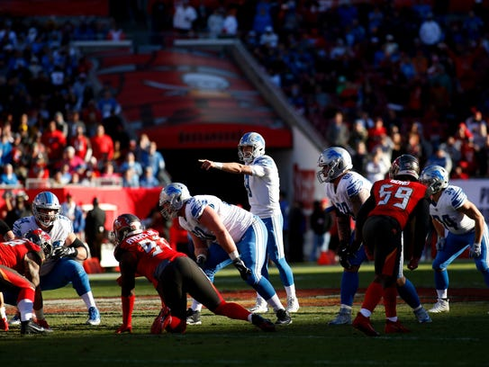 Lions quarterback Matthew Stafford at the line of scrimmage