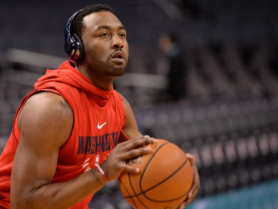John Wall warms up before a game against the Charlotte
