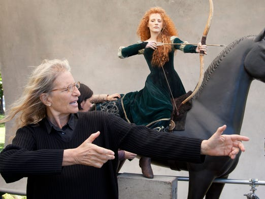 Acclaimed photographer Annie Leibovitz, front, gives direction to Jessica Chastain as she portrays Merida, the adventurous princess from the motion picture 'Brave.'