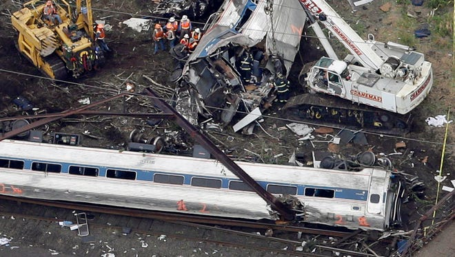 Emergency personnel work at the scene of the deadly Amtrak derailment Wednesday.