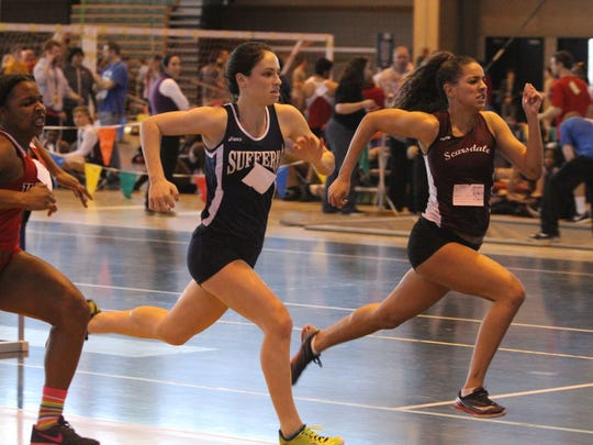 Scarsdale's Hailey Thornton, right, edges out Kyra Greenbaum from Suffern in the 55-meter hurdles.