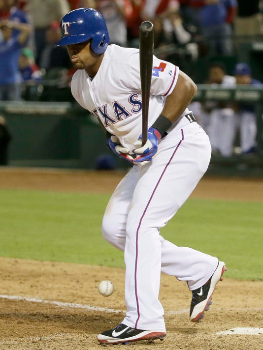 Texas Rangers' Adrian Beltre reacts to hitting a foul ball off his stomach during the ninth inning of a baseball against the Kansas City Royals in Arlington, Texas, Tuesday, May 12, 2015. The Royals won 7-6 in 10 innings. (AP Photo/LM Otero)