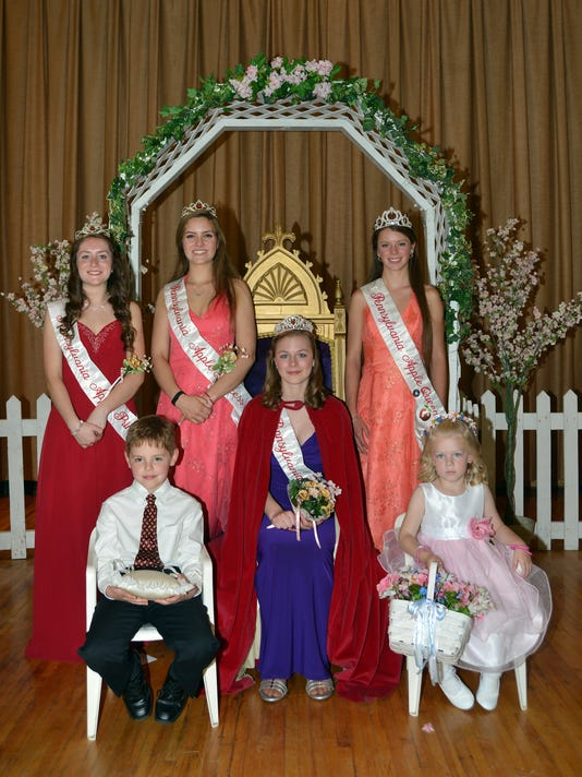 2015 Apple Queen Summer Showers is flanked by members of her court during the May 3 coronation ceremony.
