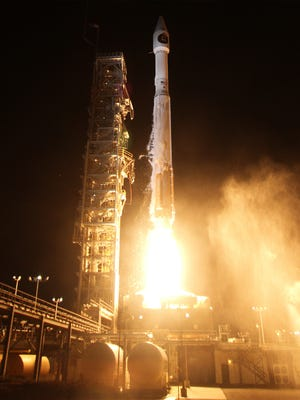 An Atlas V rocket carrying the National Reconnaissance Office's classified NROL-55 mission and 13 CubeSats lifted off from Vandenberg Air Force Base in California on Oct. 3, 2015.