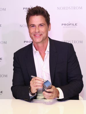 """Rob Lowe celebrates the launch of """"Profile"""" men's performance grooming products on Oct. 2 in Los Angeles. The 'Grinder' star came under fire this weekend for his controversial tweets about the Paris attacks."""