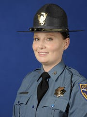 This July 2015 photo provided on Nov. 16, 2015 by the Colorado State Patrol shows thirty-three-year-old Colorado State Patrol trooper Jaimie Jursevics, who authorities say was killed after being struck by a car while investigating an accident on an interstate south of Denver. Jursevics was hit on southbound Interstate 25 near Castle Rock, Colo., around 9 p.m. Sunday, Nov. 15, 2015. The state patrol says the driver who hit her was taken into custody, but investigators haven't released details about the crash. (Colorado State Patrol via AP)