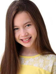 Anna Veres, 10, of South River, makes her off-Broadway