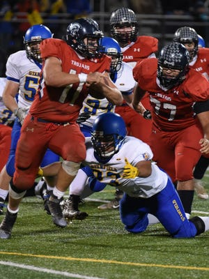 Running back Jacob Lopez runs the ball for Kennedy on Saturday night.