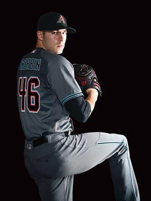 The alternate road uniform incorporates teal into the color scheme.