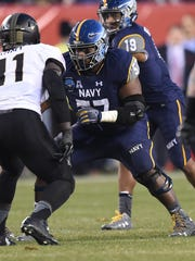 E.K. Binns, an Island Coast grad, heads into his final game with Navy on Dec. 28. The left guard has led a tremendous career and a similar life, which started before he even stepped foot on Navy's campus.