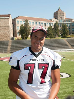 Surrounded by teammates, family and administration Asheville High School senior linemen Pete Leota officially committed to play football at the University of South Carolina next season.