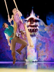 "Rapunzel and Flynn soar on the ice and above it in ""Dare to Dream."""