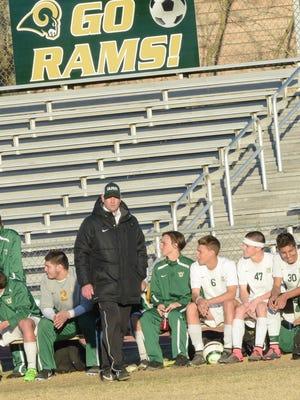 Coach Jan Richard looks on as his Acadiana High Soccer team takes on Brother Martin High School. Feb 10, 2016.