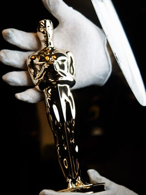 In this Jan. 5, 2016 photo provided by the Academy of Motion Picture Arts and Sciences, to give the Oscar statuette seen here in Brooklyn, N.Y., their striking appearance, all surfaces have to be perfect. Gold plating is only one micron thick and would not cover even the smallest indent; therefore to accomplish a perfect surface, the castings are plated first with copper, then nickel, and polished to a high luster.  The film academy announced Tuesday, Feb. 16, 2016, that a New York foundry is restoring features of the original design from 1929 to the Oscar statuettes for 2016 using digital scans and 3-D printers.