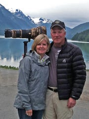 Peg and Harry Nieman on one of their trips capturing wildlife scenes. Harry Nieman has spent 30 years traveling the globe, much of that time with a camera in hand.