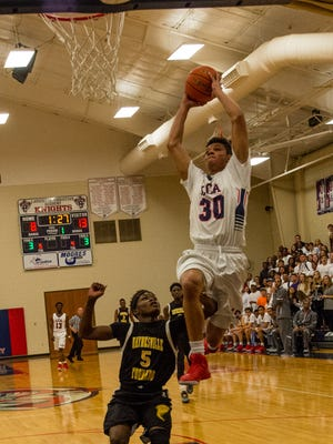 Jacob Ledoux goes up for the basket as Lafayette Christian rolled past Haynesville in Tuesday's Class 1A regional contest.