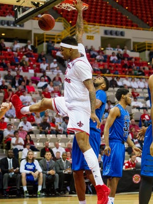 UL's Shawn Long, shown here dunking in Thursday night's loss to Georgia State, will be one of six Cajuns playing his final regular-season game at the Cajundome on Thursday night.
