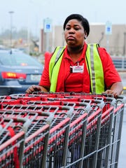 Treasure Lewis prepares for the opening of the new Costco in the Ambassador Shopping Center. March 17, 2016.