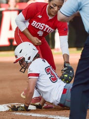 Haley Haden dives back safely to first as the Cajuns face Boston University in the NCAA Softball Regionals.