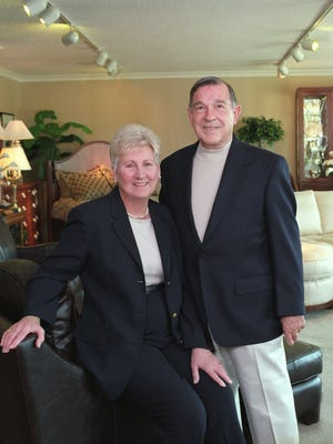 Johnny Janosik and his wife, Mary, at their furniture store. He died Friday at the age of 90.