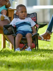 Kasen Boatman watches performances and speakers July 30 at the Career Guidance and Motivational Lectures event at Louisiana Avenue United Methodist Church.