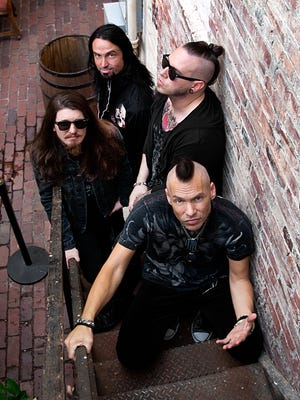 The new Blackfoot (clockwise from top): Bassist Brian Carpenter, drummer Matt Anastasi, lead singer/guitarist Tim Rossi and singer/guitarist Rick Krasowski.
