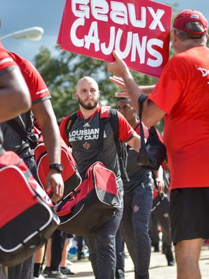Players arrive and greet fans at Cajun Field during tailgating  as UL takes on McNeese for the second game of the season.Cajun fans tailgate as UL takes on McNeese for the second game of the season.