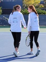 Indian Hill High School's Gracey [left] and Hayley Hirsch congratulate each other after winning a game in the OHSAA girls' tennis semifinals Saturday at the ATP Tennis Center in Mason, Ohio.