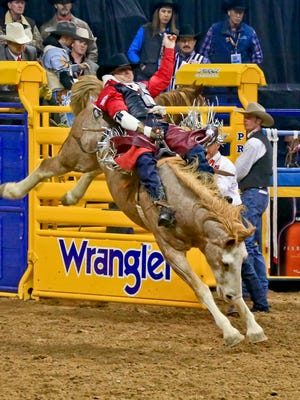 Jessy Davis competes in the bareback riding portion of the NFR in Las Vegas, Nev., on Friday.