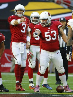 Arizona Cardinals quarterback Carson Palmer (3) and center A.Q. Shipley (53) communicate  against the Washington Redskins  during their NFL game Sunday, Dec. 4, 2016 in Glendale, Ariz.
