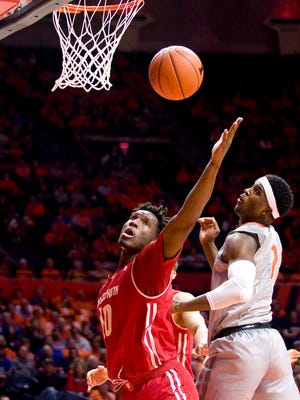 Badgers forward Nigel Hayes reaches for a rebound.