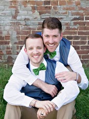 Rev. Kevin Cravens-Koch, left, and his husband Ryan