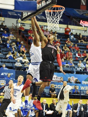 The college career of UL senior point guard Jay Wright (1), shown here blocking a shot at the basket in Friday night's Sun Belt Tournament loss to Georgia State, may not be done yet.
