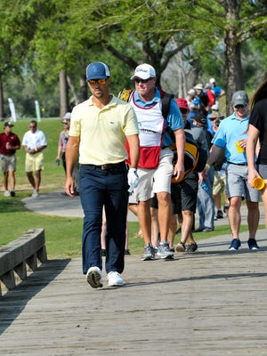 Casey Wittenberg walks over a bridge at Le Triomphe during the final round of his 2017 Louisiana Open crown last March.