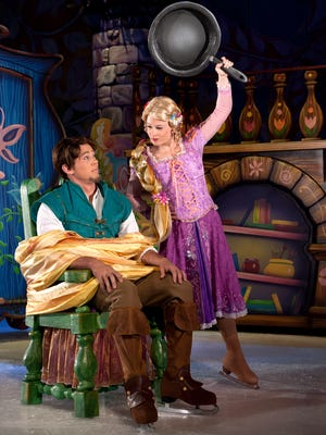 """Joe Jacobsen, left, plays Flynn Rider in Rapunzel's story, part of """"Disney on Ice presents Dare to Dream."""""""