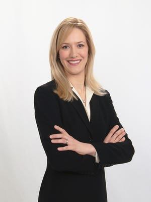 Ingrid Tighe, a former captain in the U.S. Army, now serves as the executive director for the Birmingham Shopping District.
