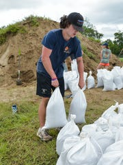 Students help to fill and distribute sand bags in Youngsville.  Wednesday, June 21, 2017.