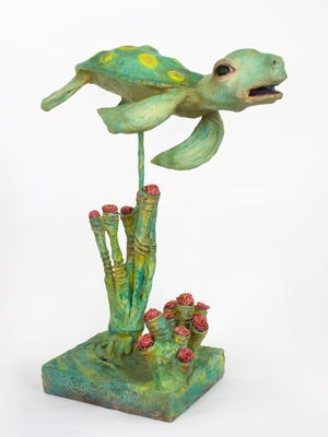 """Bonny is one of about 30 sculptures in Jeff and Dale Ocasio's """"Fin Folk"""" exhibit."""