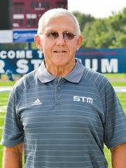 St. Thomas More head football coach Jim Hightower has a career record of 396-122-1.