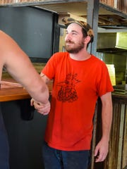 John Hackney is working to open a brick-and-mortar version of his food truck, Wing Fingers.