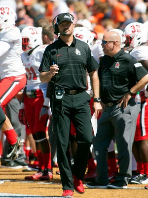 Ball State head coach Mike Neu observes his team in action against the Illinois Fighting Illini during the first quarter on Saturday, Sept. 2 at Memorial Stadium.