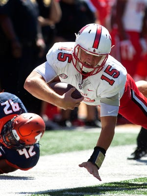 Ball State Cardinals quarterback Riley Neal reaches for an extra yard against the Illinois Fighting Illini during the third quarter Sep. 2, 2017 at Memorial Stadium in Champaign, IL.