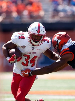 Ball State Cardinals running back James Gilbert (34) carries the ball against the Illinois Fighting Illini during the third quarter Sept. 2, 2017 at Memorial Stadium.